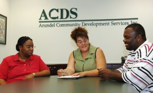 ACDS employee helping homebuyers