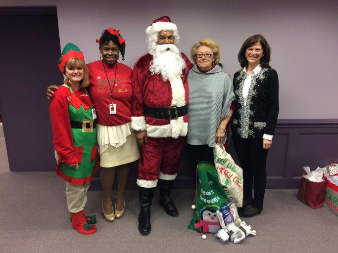 Man dressed as santa with staff members and socks
